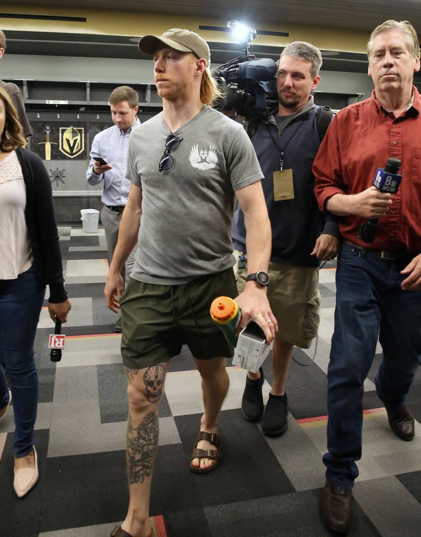 Golden Knights center Cody Eakin enters team's locker room to address the media at City Nationa ...