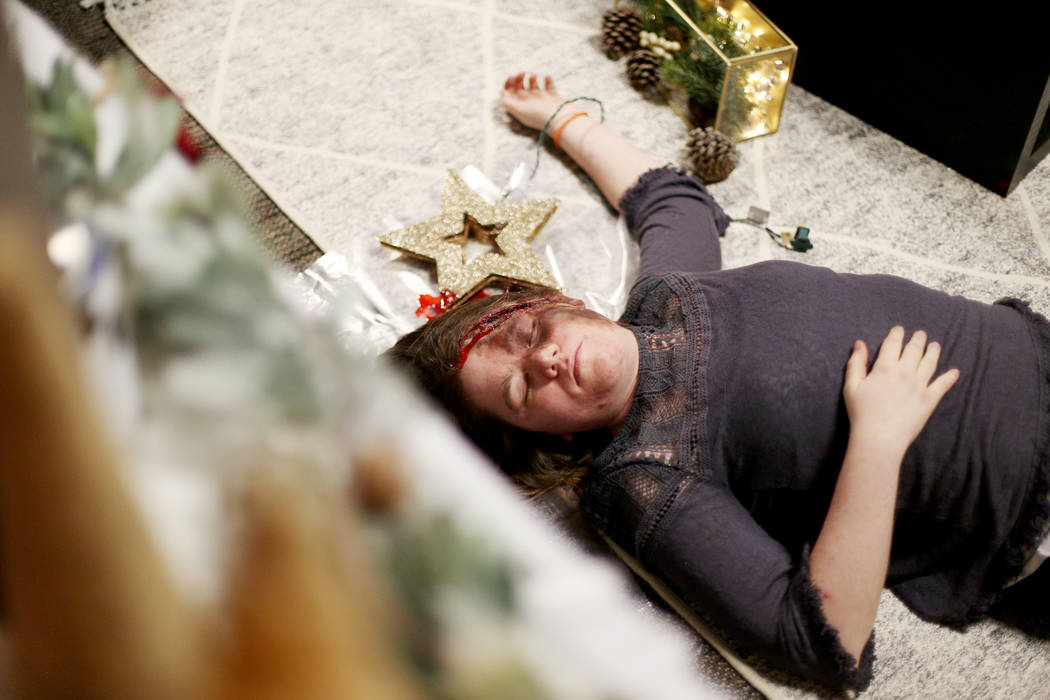 Kelsey Geralds pretends to be dead for a fake crime scene that allows kids of city employees to ...