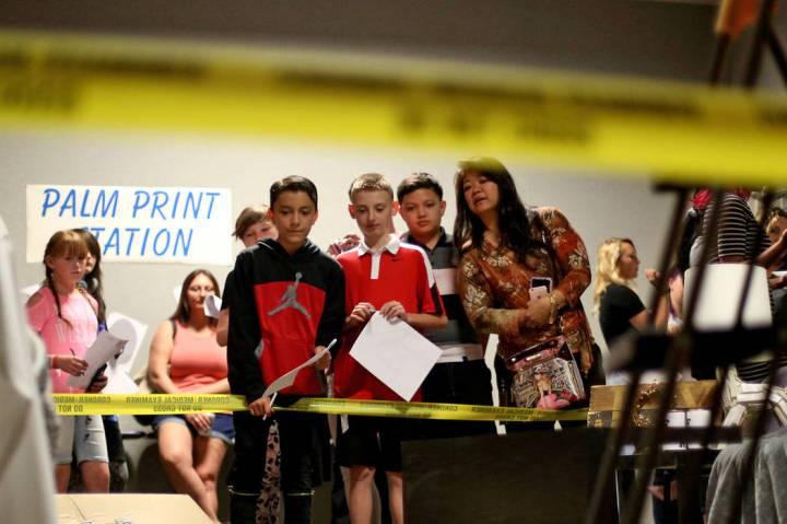 Isaiah Cordova, 12, from left, Alex Holliday, 11, Jordan Noble, 13, and his mom Suzan Noble exa ...