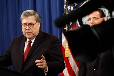 Attorney General William Barr speaks alongside Deputy Attorney General Rod Rosenstein about the ...