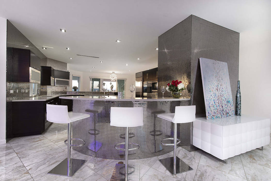 The kitchen has a bar. (Sotherby's International Realty, Synergy)