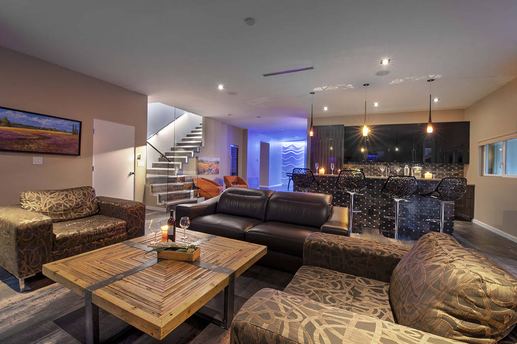 A room downstairs has a bar and sitting areas. (Sotherby's International Realty, Synergy)