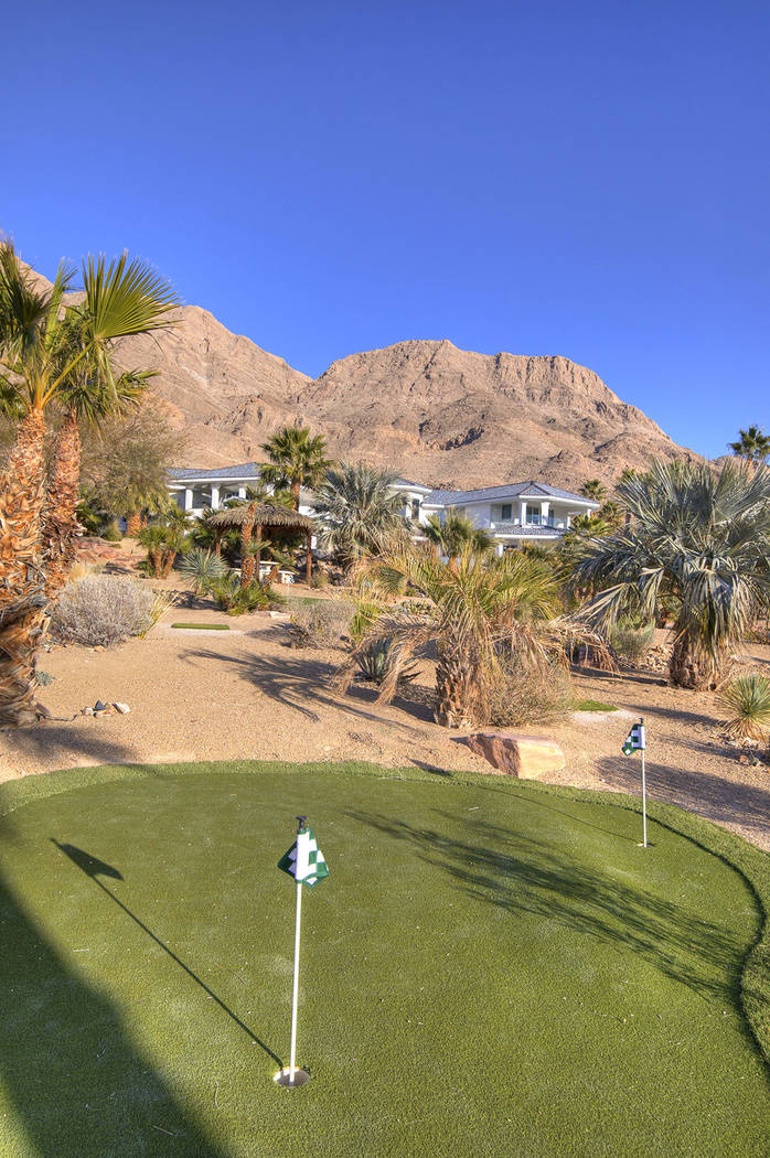 A six-hole putting green lies beneath the palm trees. (Sotherby's International Realty, Synergy)