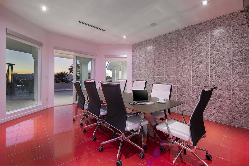 The downstairs features a conference room. (Sotherby's International Realty, Synergy)