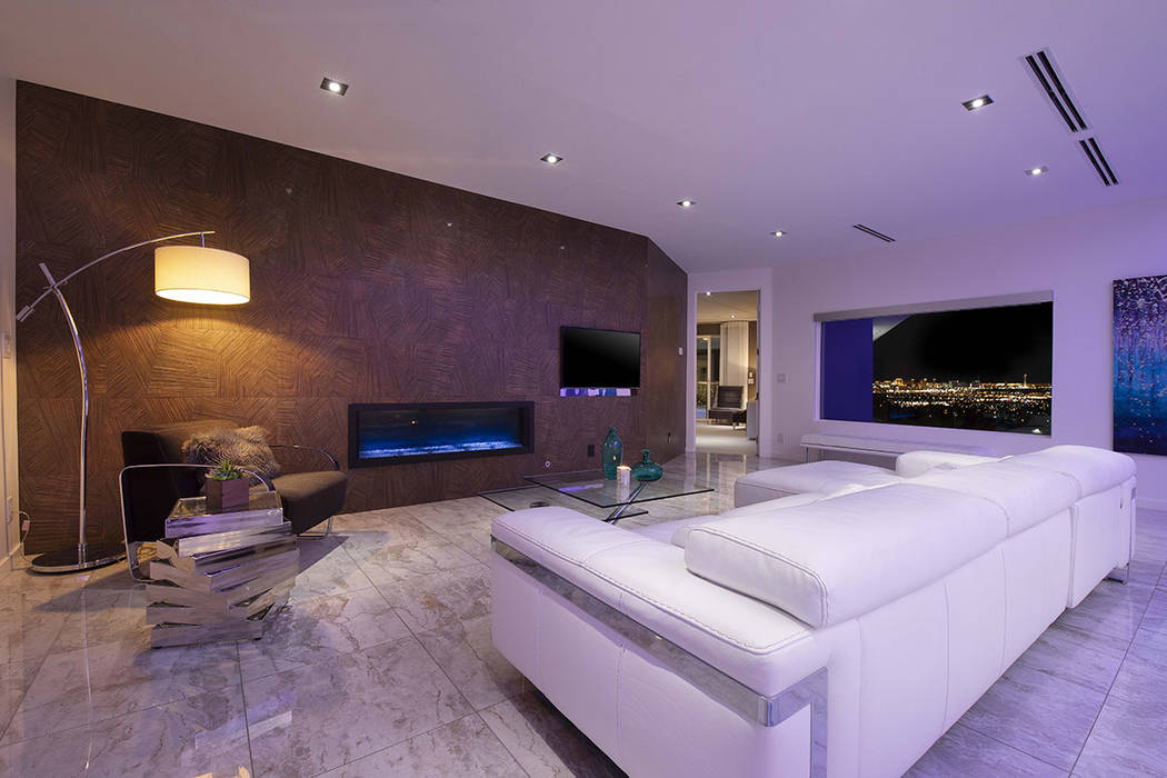 The living area features a horizontal fireplace. (Sotherby's International Realty, Synergy)
