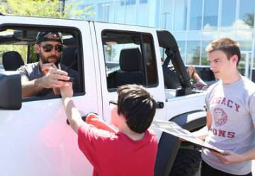 Golden Knights defenseman Deryk Engelland signs autographs for fans outside City National Arena ...