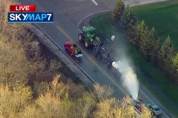 In this still image from video provided by ABC7 Chicago, a fire engine sprays water on a contai ...