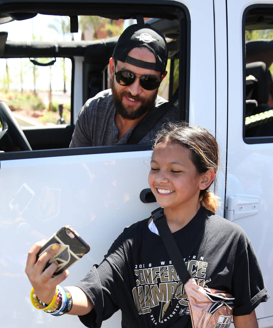 Golden Knights defenseman Deryk Engelland poses for a selfie with Ciera Soto, 11, outside City ...
