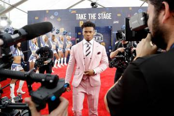 Oklahoma quarterback Kyler Murray walks the red carpet ahead of the first round at the NFL foot ...