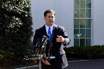 Arizona Gov. Doug Ducey talks to reporters outside the West Wing of the White House in Washingt ...