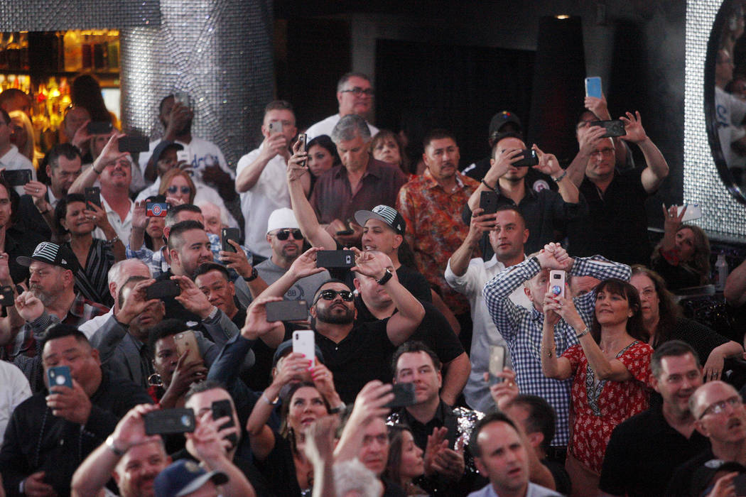 A crowd reacts to the fourth draft pick of Defensive End Clelin Ferrell at a Raiders draft part ...