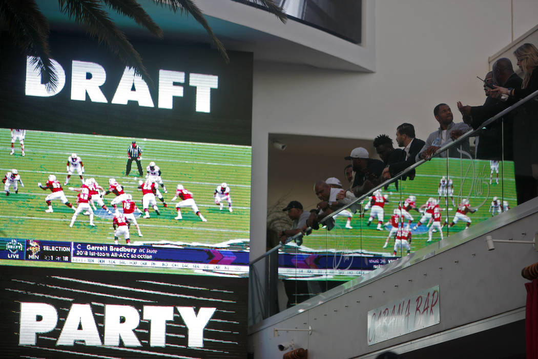Crowds watch and mingle during a Raiders draft party at Drai's nightclub at The Cromwell hotel- ...