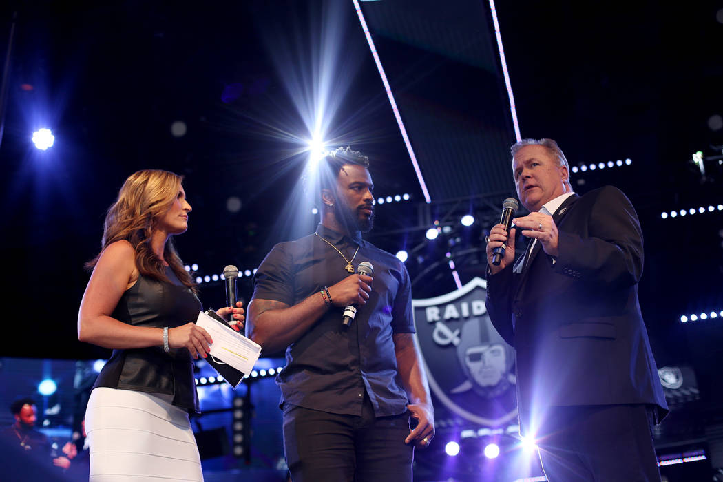Nicole Zaluomis, host of The Silver and Black Show, and former Raiders player Marcel Reece, and ...