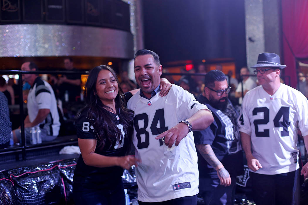 Veronica Diaz, left, laughs with husband Kevin Shaughnessy at a Raiders draft party at Drai's n ...