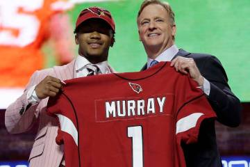 Oklahoma quarterback Kyler Murray poses with NFL Commissioner Roger Goodell after the Arizona C ...