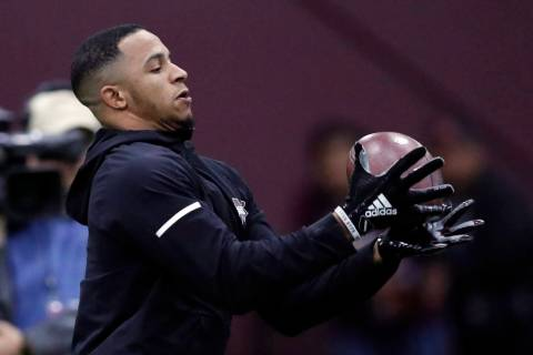 Former Mississippi State safety Johnathan Abram reaches for a pass during drills while getting ...