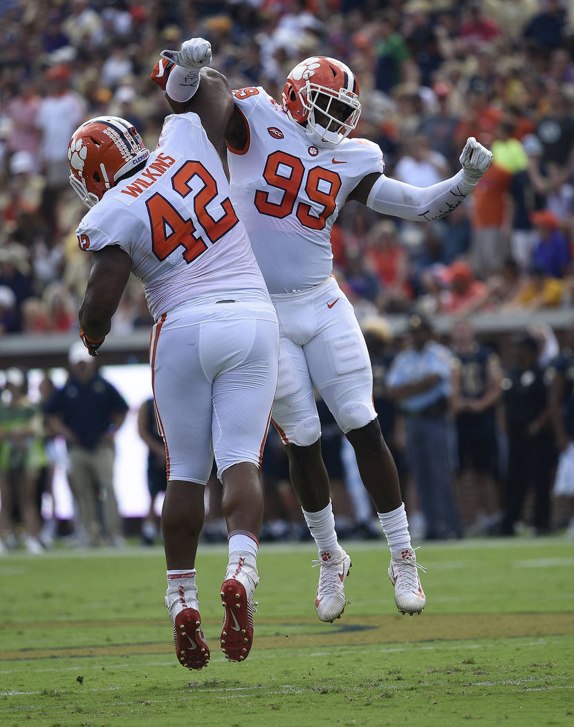 In this Sept. 22, 2018, file photo, Clemson defensive end Clelin Ferrell (99) and defensive lin ...
