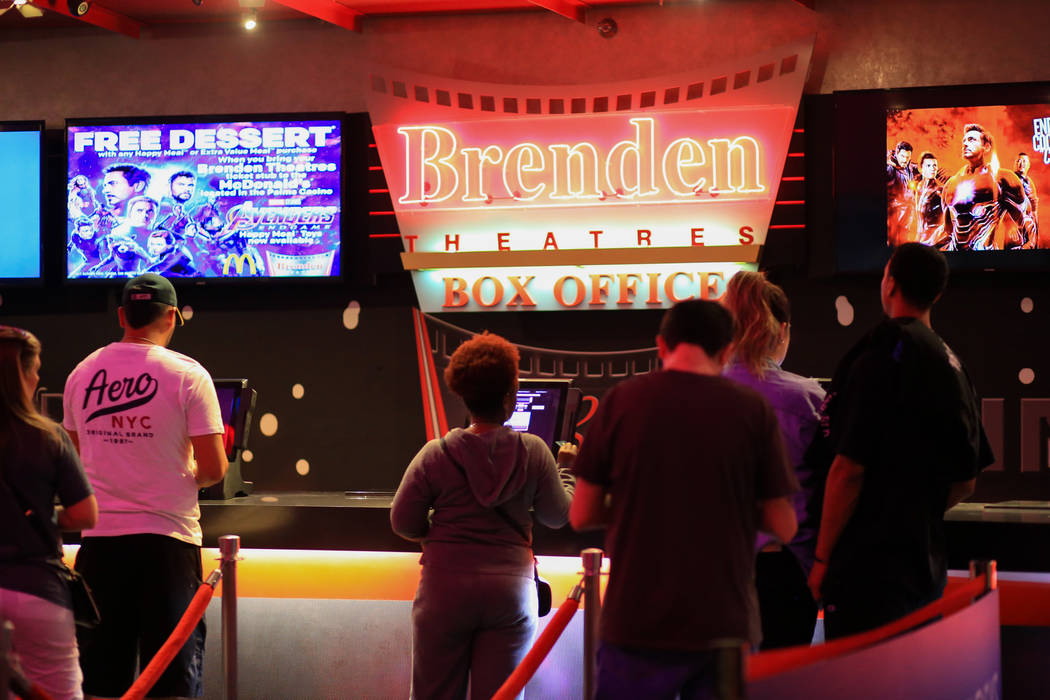 """Moviegoers buy tickets before the first showing of """"Avengers: Endgame"""" at Brenden Theaters at t ..."""