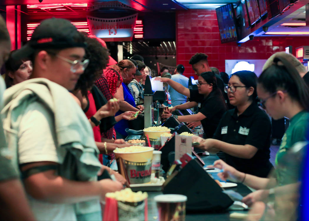 "Moviegoers get their concession fix before first showing of ""Avengers: Endgame"" at Brenden Thea ..."
