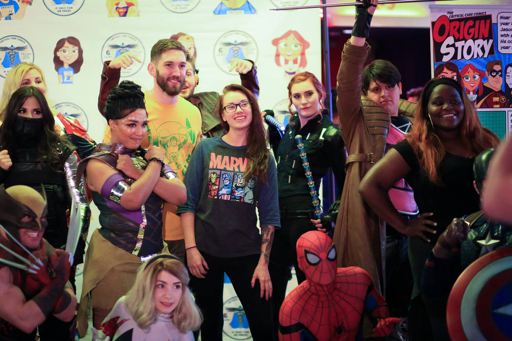 "Fans get their photos taken with Critical Care Comics cosplayers before the first showing of ""A ..."