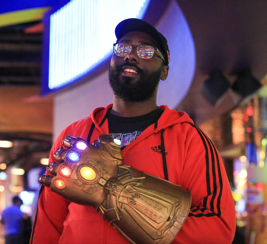 "Justin Vinson, 25, wears his Infinity Gauntlet before the first showing of ""Avengers: Endgame"" ..."