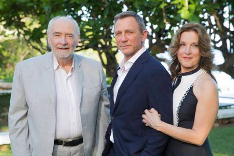 Producers Michael G Wilson, left, and Barbara Broccoli, right, pose for photographers with acto ...
