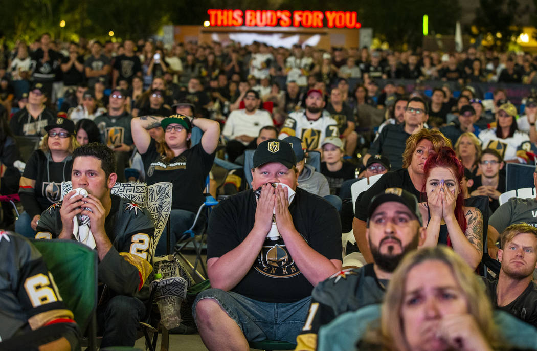 Golden Knights fans Randy Trent, Michael and Rebecca Moore sit dismayed as the San Jose Sharks ...