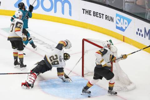Knights goaltender Marc-Andre Fleury (29) gets turned around after Sharks right wing Barclay Go ...