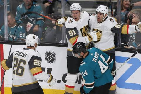 Golden Knights left wing Max Pacioretty (67) celebrates with teammates Mark Stone (61) and Paul ...