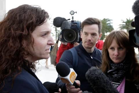 An assistant federal public defender Brenda Weksler addresses the media outside the Lloyd Georg ...