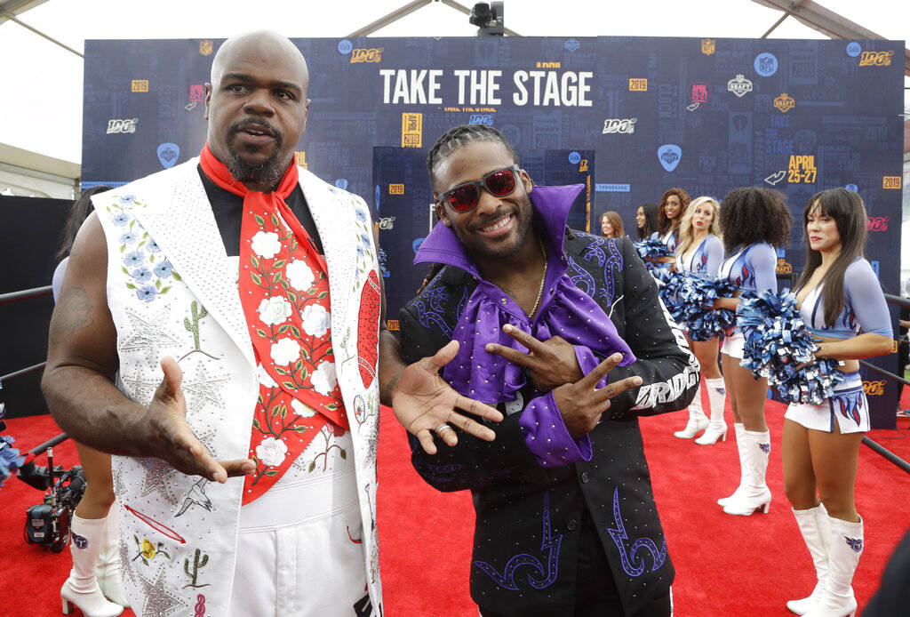 Vince Wilfork, left and DeAngelo Willimas walk the red carpet ahead of the first round at the N ...