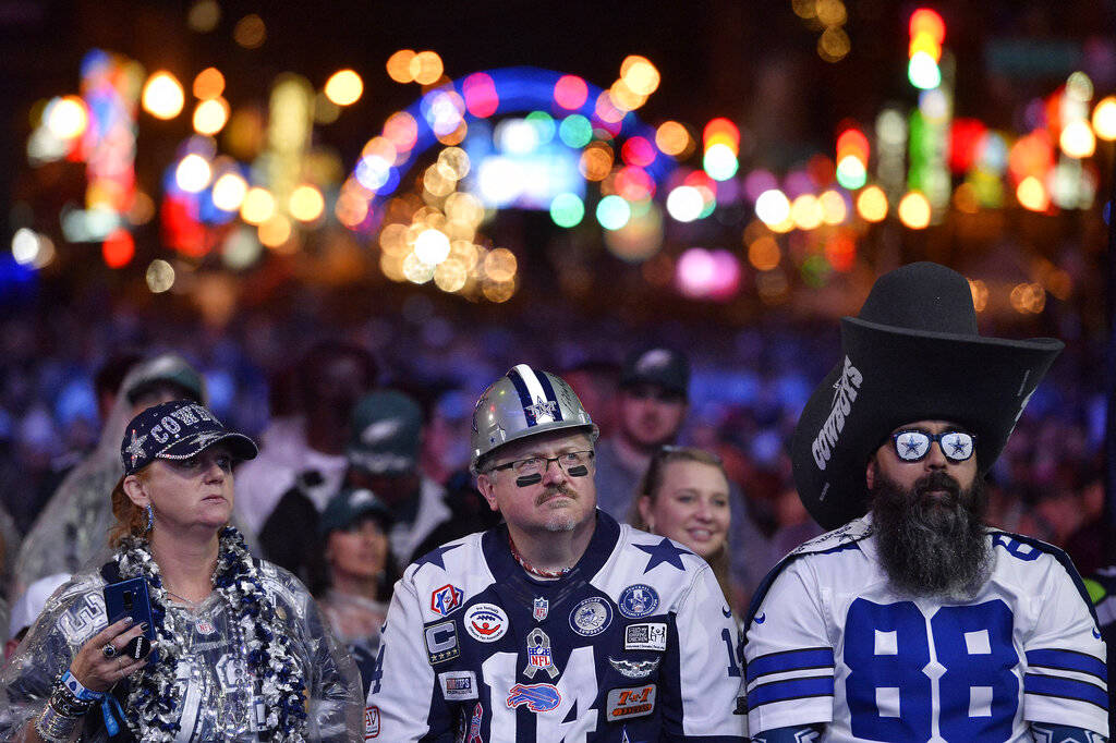 Dallas Cowboys fans watch attend the 2019 NFL Draft Thursday, Apr. 25, 2019, in Nashville, Tenn ...