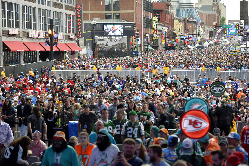 Fans crowd Broadway during the 2019 NFL Draft Thursday, Apr. 25, 2019, in Nashville, Tenn. (AP ...