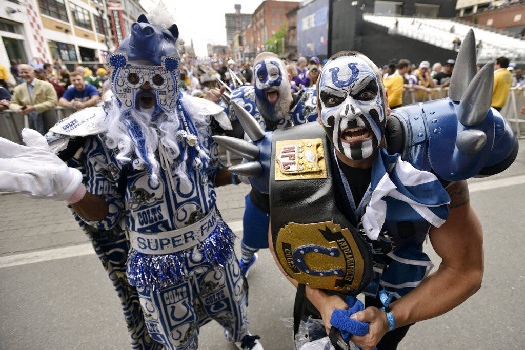 Indianapolis Colts fans pose for a photo during the 2019 NFL Draft Thursday, Apr. 25, 2019, in ...