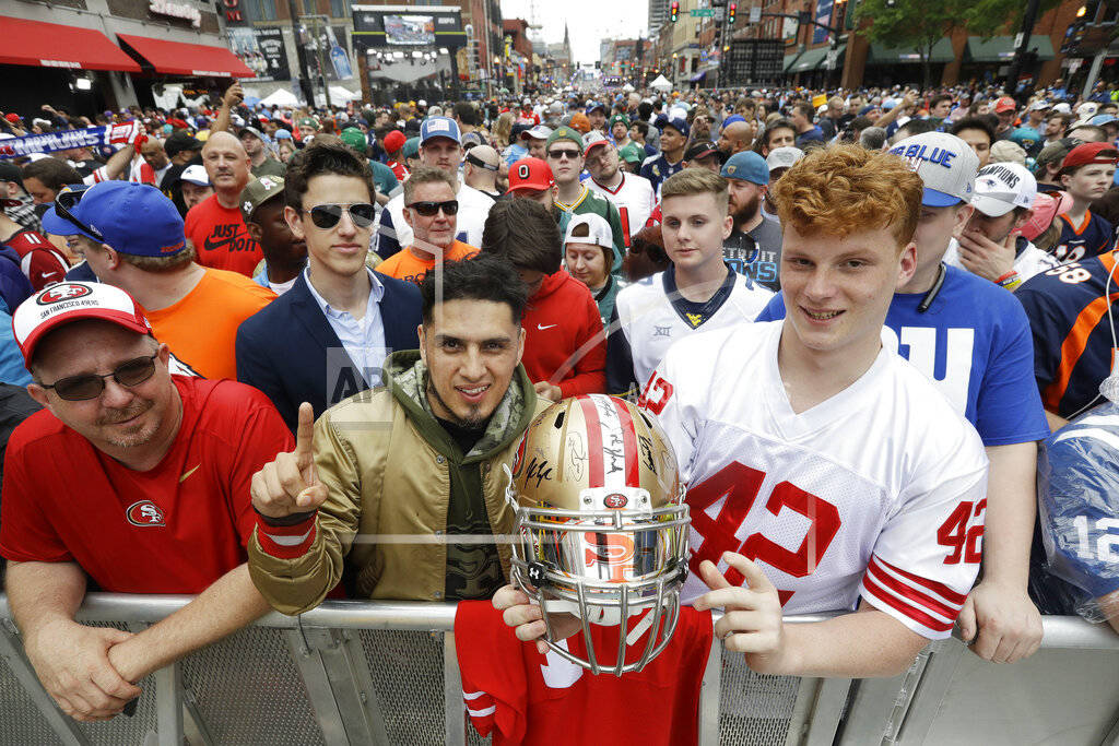 Fans pose for a photo ahead of the first round at the NFL football draft, Thursday, April 25, 2 ...
