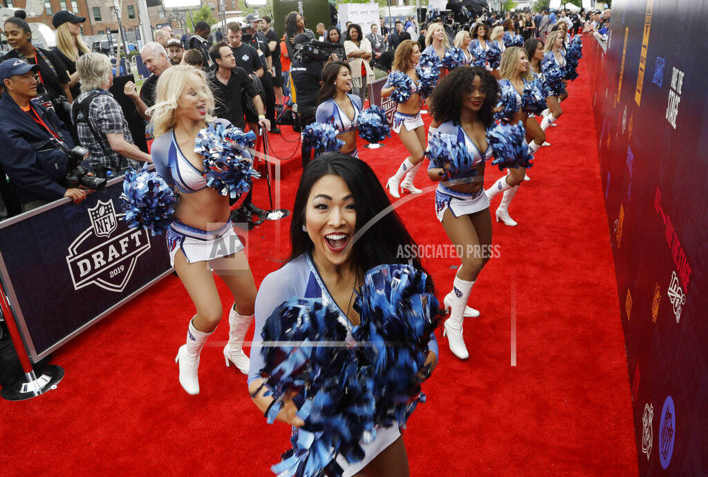 Tennessee Titans cheerleaders perform on the red carpet ahead of the first round at the NFL foo ...