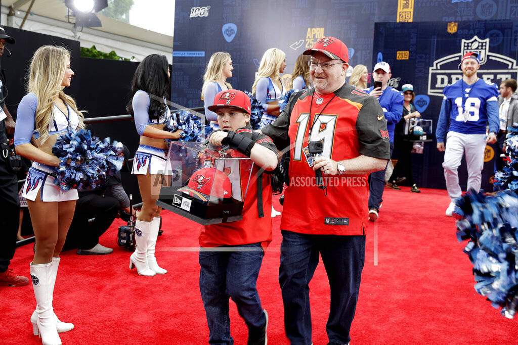 Fans walks the red carpet ahead of the first round at the NFL football draft, Thursday, April 2 ...