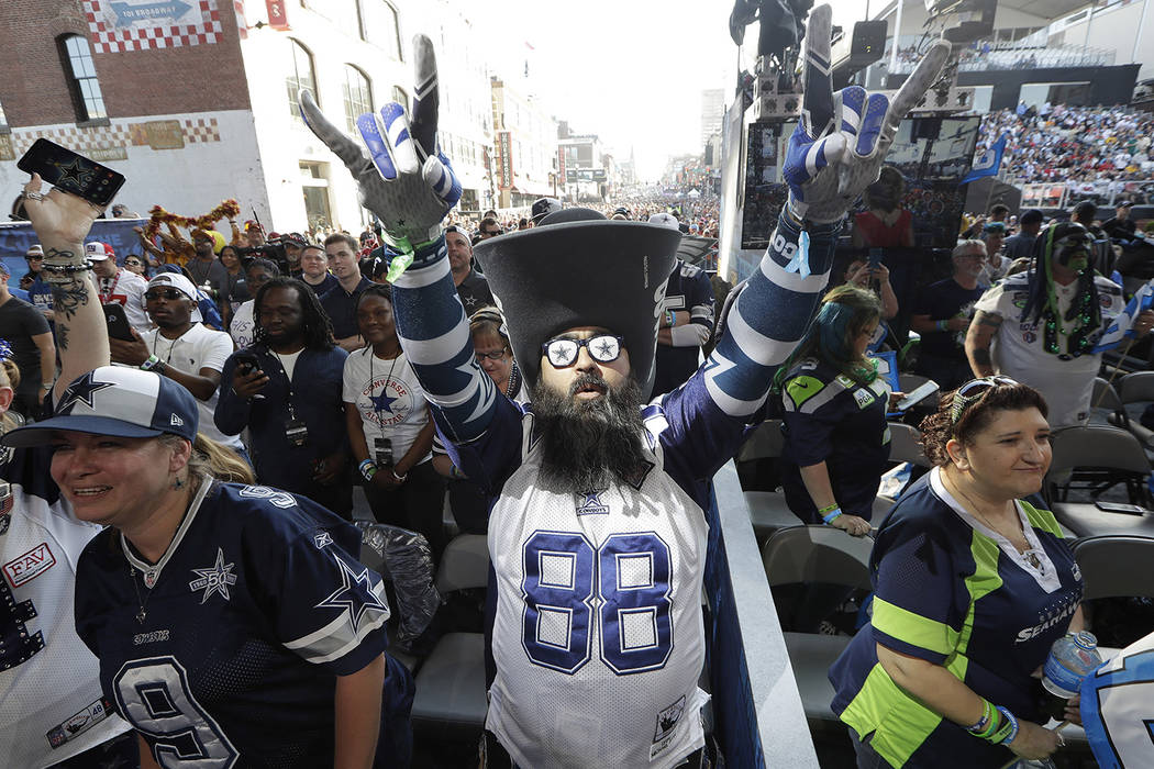 Dallas Cowboys fan Matt Franco, of of Austin, Texas, stands on the main stage ahead of the seco ...