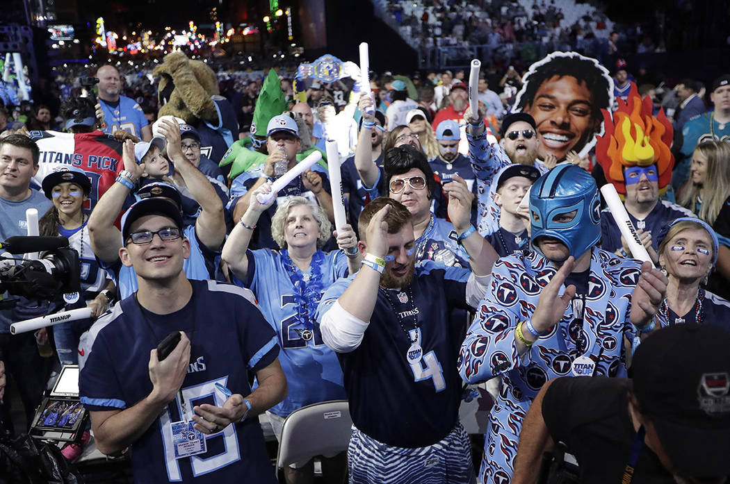 Fans watch the action on the main stage during the first round at the NFL football draft, Thurs ...