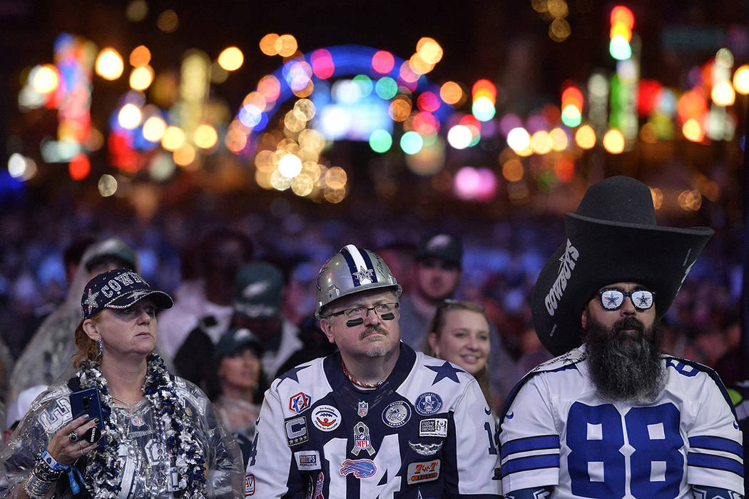 Dallas Cowboys fans watch attend the 2019 NFL Draft Thursday, Apr. 25, 2019, in Nashville, Tenn ...