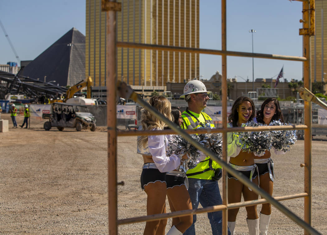 Labor concrete foreman Dave Durbin is flanked by the Raiderettes as he helps the Raiders announ ...