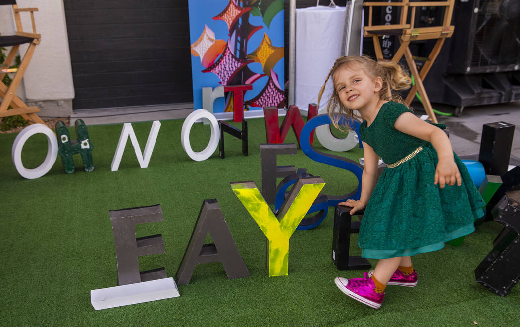 Faye Kerlin Stoelting, 3, is pleased to spell out her name during the Believer Festival, a thre ...