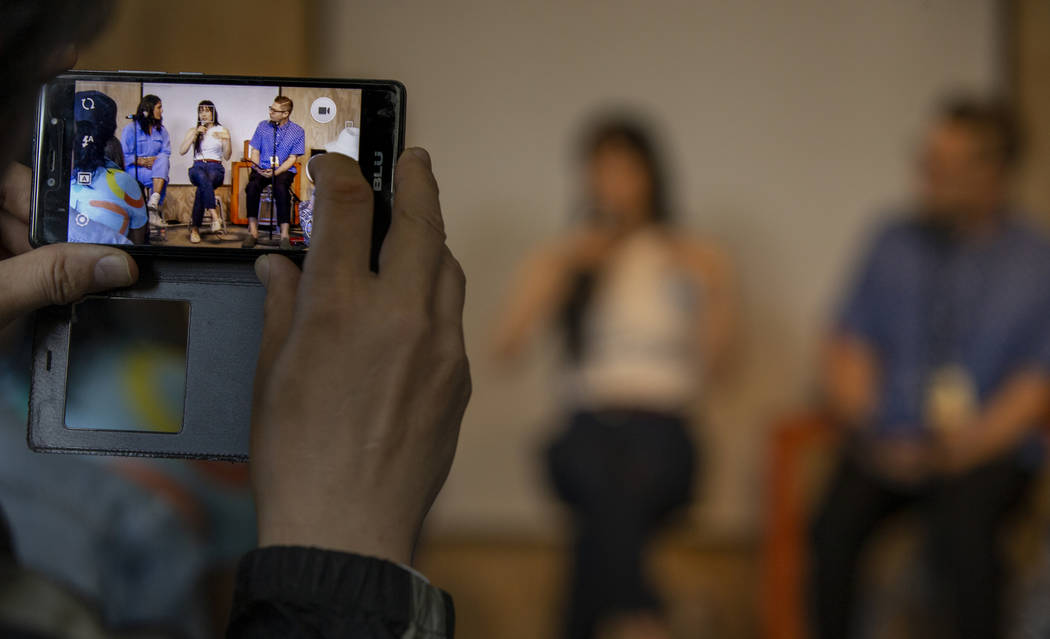 A participant grabs some video of Author Mira Jacob, singer Thao Nguyen and author Josh Kun in ...