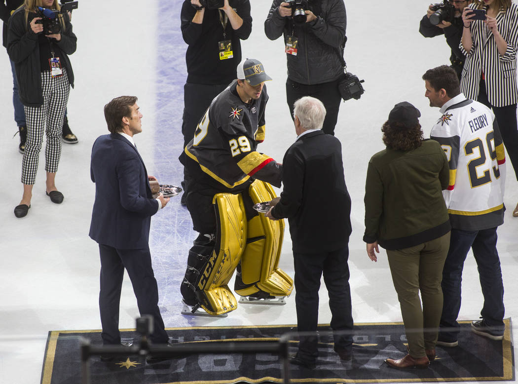 Golden Knights goaltender Marc-Andre Fleury (29) shakes hands with team owner Bill Foley after ...