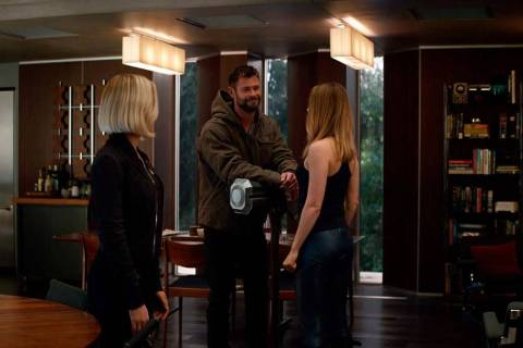 This image released by Disney shows, from left, Scarlett Johansson, Chris Hemsworth and Brie La ...