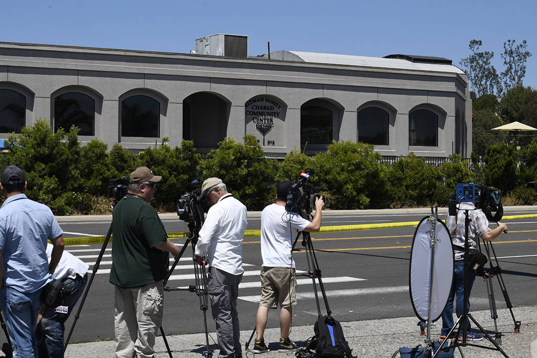 Television cameras film the outside of the Chabad of Poway Synagogue Saturday, April 27, 2019, ...