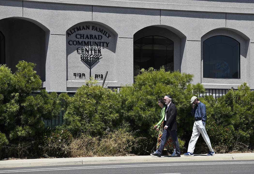 Synagogue members walk outside of the Chabad of Poway Synagogue Saturday, April 27, 2019, in Po ...