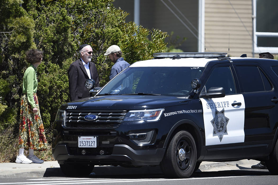 Synagogue members stand outside of the Chabad of Poway Synagogue Saturday, April 27, 2019, in P ...