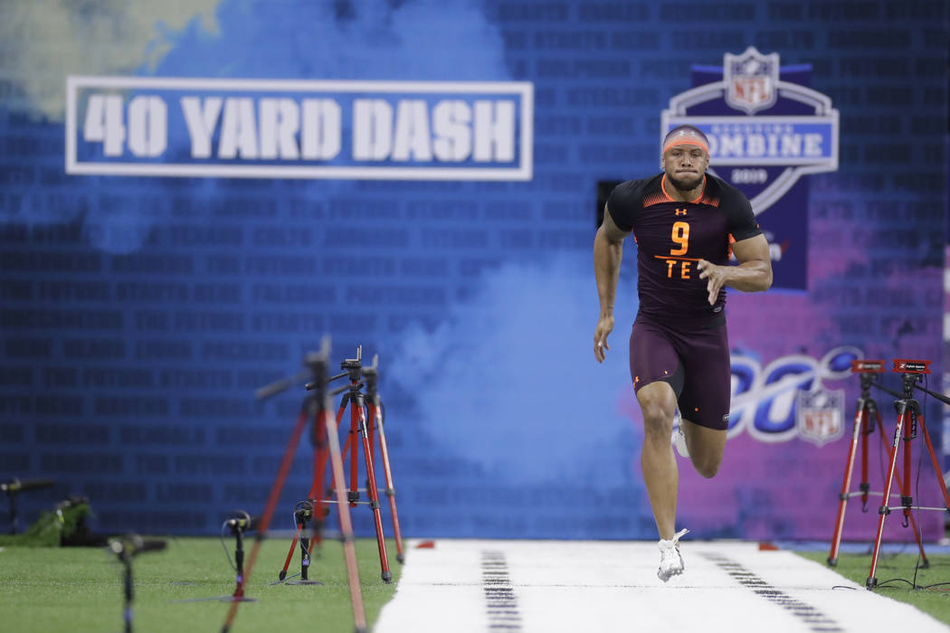 Notre Dame tight end Alize Mack runs the 40-yard dash during the NFL football scouting combine, ...