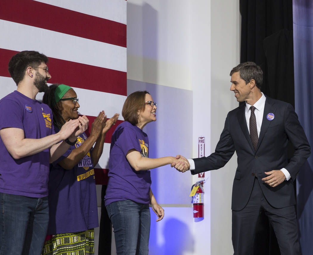 Presidential candidate and former Texas congressman Beto O'Rourke, right, shakes hands with sup ...